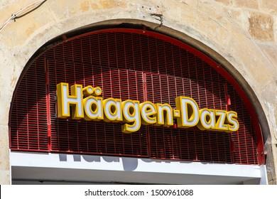 Valletta, Malta - August 13th 2019: The Haagen Dazs company logo on the exterior of their shopfront on Republic Street in Valletta, Malta.