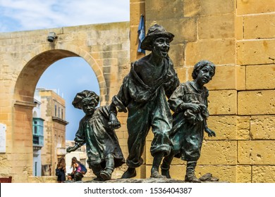 Valletta, Malta - August 30, 2019: Replica of the statue Les Gavroches (Street boys), which represents three poor street children roaming streets of Paris during tumultuous days of the 1848 revolution