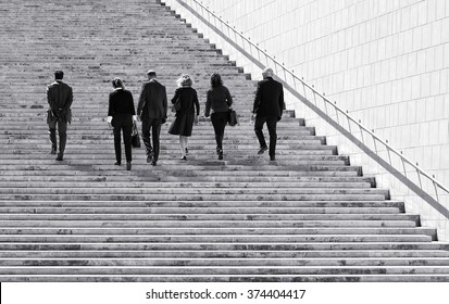 Valletta, MALTA - Dec 6: group of business people walking in Valletta, Malta on Dec 6, 2015..Black and white photo. People in the street. Ambitions concept with businessman climbing stairs