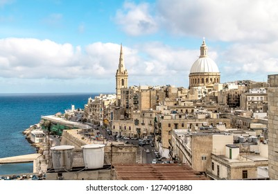 Valletta, Malta - December 23, 2018;Ancient stone buildings in Valletta on a sunny day