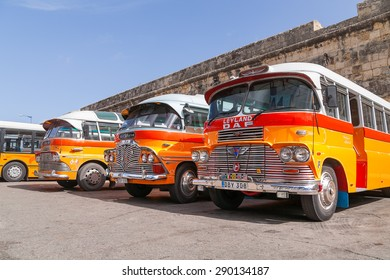 VALLETTA, MALTA - February 13, 2010. Colorful old British buses from the 60s were used as public transport in Malta.