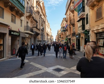 Valletta, Malta - February 23, 2019: People on the central street of the city