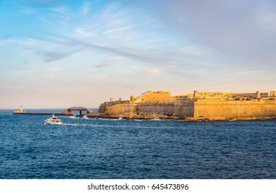 Valletta, Malta. Fort Saint Elmo and Breakwater with the lighthouse at sunset