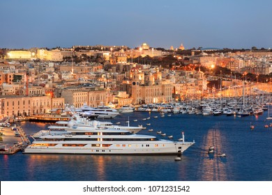 Valletta, Malta. Grand harbour, luxury yachts marina view from Upper Barrakka Gardens in the evening