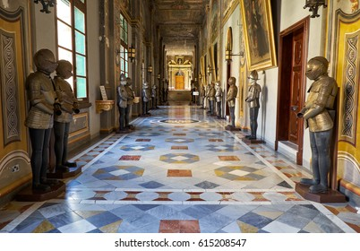 VALLETTA, MALTA - JULY 31, 2015: The view of the long Armoury Corridor on the main floor of the Grandmaster's Palace with the suits of armour of the Maltese Knights of St John. Valletta. Malta