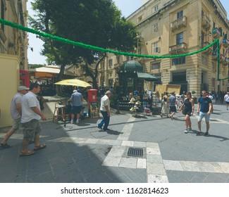 Valletta, Malta - July 4, 2018: People walking on Republic Street Valletta, Summer 2018