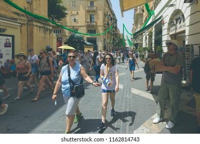 Valletta, Malta - July 4, 2018: Crowd of People walking on Republic Street Valletta, Summer 2018