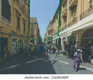 Valletta, Malta - July 4, 2018: Crowd of People on Republic Street Valletta, Summer 2018