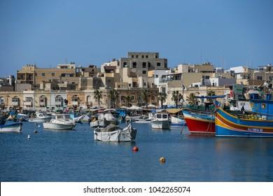 Valletta, Malta - July 9 2017: Small fishing boats in the harbor of Malta