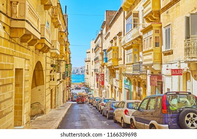 VALLETTA, MALTA - JUNE 17, 2018: The gentle descent of St Lucia's street leads to the sea and ferry terminal of Sliema direction, on June 17 in Valletta.