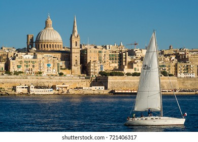 Valletta, Malta - June 3rd, 2012: A sailing boat passes by in front of the unique skyline of Maltas capital Valletta.