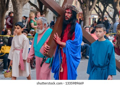 VALLETTA, MALTA - Mar 30, 2018: Biblical enactment of the passion (actor carries cross) during in the Good Friday procession.