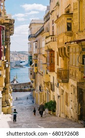 Valletta, Malta - March 12 2017: Old Town street with traditional maltese balconies and fascinating sea view. Morning hours, City of Valletta