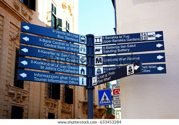 VALLETTA, MALTA - MARCH 30, 2017 - Signpost on corner of Castille Street and Triq San Pawl, Valletta, Malta, Europe, March 30, 2017.
