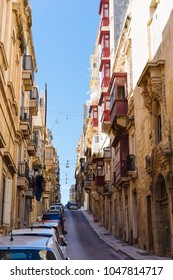 Valletta, Malta - March 6 2017: Street view of Valletta Old Town with traditional maltese houses and wooden balconies.