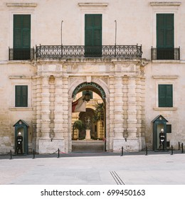 Valletta, Malta - March 7 2017: Main entrance of The Grandmaster's Palace (also known as Governor's Palace) with two AFM soldiers standing guard, City of Valletta