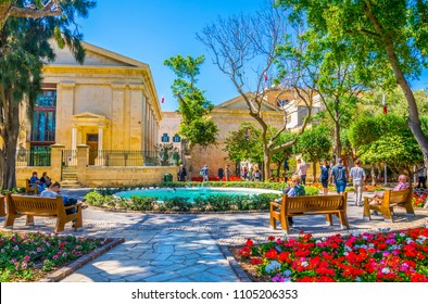 VALLETTA, MALTA, MAY 2, 2017: People are enjoying shade in the upper barrakka gardens in Valletta, Malta