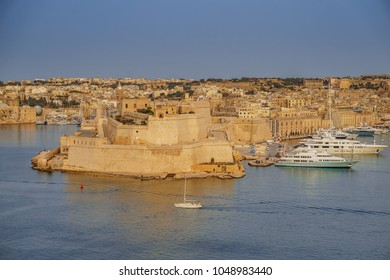VALLETTA MALTA - MAY 2016: Scenic view near upper Barrakka Gardens of saluting battery and Grand Harbor of Valletta, Malta at sunset. Panorama of the ancient city of Valletta and the Grand Harbor