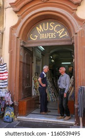 Valletta, Malta - May 2018: Two men stand in old door shop in Valletta