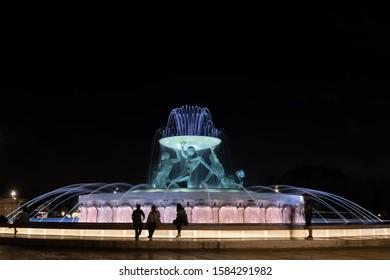 Valletta, Malta - October 13, 2019: Triton Fountain illuminated at night, famous city landmark.