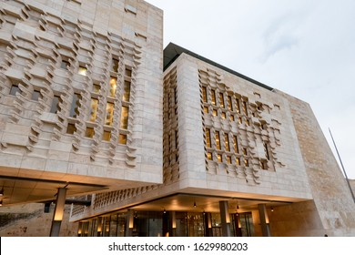 VALLETTA, MALTA - OCTOBER 28, 2019: The modern contemporary building of the Maltese Parliament House (Dar il-Parlament) at dusk