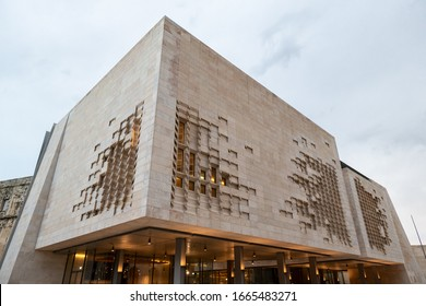 VALLETTA, MALTA - OCTOBER 28, 2019: The modern contemporary building of the Maltese Parliament House (Dar il-Parlament) with lights on