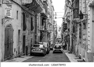 Valletta, Malta, on January 8, 2019. The street in the old city repeats an area landscape. The characteristic picturesque balconies decorating facades of buildings are one of symbols of Malta