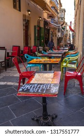 Valletta, Malta, on January 8, 2019.  Tables of street cafe in old town wait for visitors