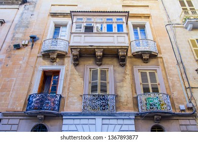 Valletta, Malta, on January 8, 2019. The various picturesque balconies characteristic of old town houses are one of symbols of Malta. Facades of buildings in the old city
