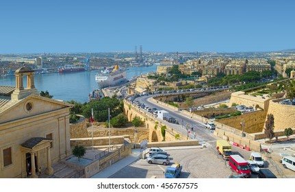 VALLETTA, MALTA - SEPTEMBER 4, 2015: View over Valletta city, Malta, with The Grand Harbour bay and typical Maltese yellowish colors of architecture of modern and ancient ages.