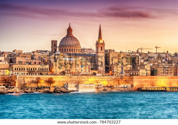 Valletta, Malta: skyline from Marsans Harbour at sunset