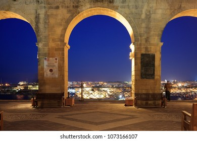 Valletta, Malta, Upper Barrakka Gardens, in the evening. Terrace with a view to the Grand harbor, clear dark blue sky.