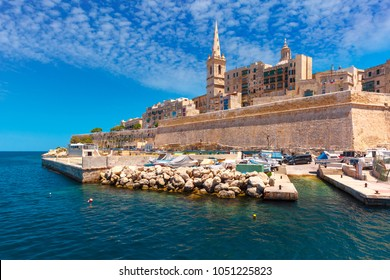 Valletta Skyline with fortress wall, boat pier and St. Paul's Anglican Pro-Cathedral, Valletta, Capital city of Malta. View from the sea