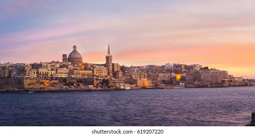 Valletta skyline at sunset with Basilica of Our Lady of Mount Carmel, viewed from Sliema, Malta