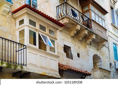 Valletta. Traditional wooden balconies of residential building. Malta