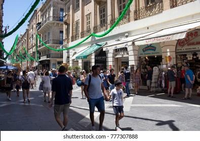 VALLETTA/MALTA - JULY 8, 2017: People walk one of the main shopping streets in Valletta city / Malta.