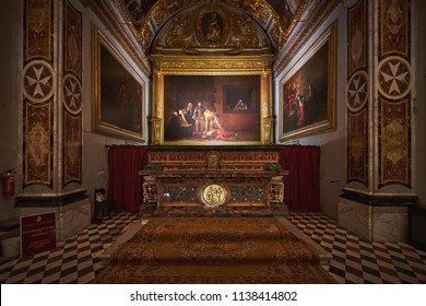 VALLETTA/MALTA - November 17, 2017: The painting depicting The Beheading of Saint John the Baptist by Caravaggio in the Oratory of St. John's Co-Cathedral at Valletta, Malta