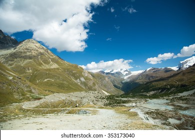 Valley in the Alps with glacier lake and path, Swiss