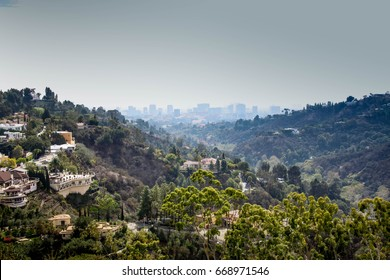 Valley of Bel Air luxury homes with building in the foggy background
