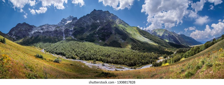 Valley in the Caucasus Mountains, green slopes and blue sky, panorama nature