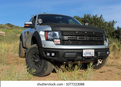 Valley Center, CA / USA - April 25, 2018: A customized 2011 Ford F-150 Raptor SVT pick-up truck on a dirt road (exterior style is the same for all 2010-2014 models)