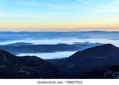 Valley in clouds as seen from the top of a mountain