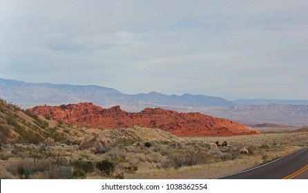 Valley of Fire Nevada from the entrance car parking lot.Bright red Aztec sandstone outcrops nestled in gray and tan limestone