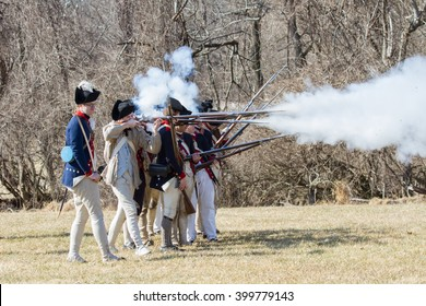 VALLEY FORGE, PA - FEBRUARY 2012: Revolutionary War soldiers fire muskets at a reenactment in Valley Forge National Historic Park