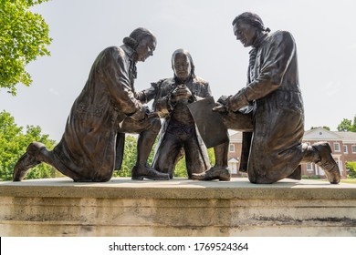 Valley Forge, PA - July, 3, 2020: Bronze statue of Founding Fathers John Adams, Benjamin Franklin and Thomas Jefferson kneeling in prayer by sculptor Stan Watts at Freedoms Foundation of Valley Forge.