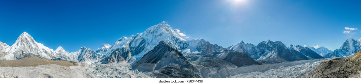 Valley of Himalayan mountains on track to Everest base camp. High mountains with snow-capped peaks. Khumbu valley, Sagarmatha national park of Nepal. Beautiful mountain landscape, Himalayan heights.