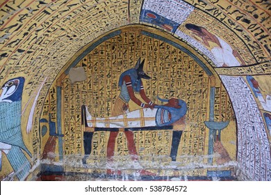 THE VALLEY OF THE KINGS, LUXOR, EGYPT - NOVEMBER 11, 2016: Wall painting and decoration of the tomb: ancient Egyptian gods and hieroglyphs in wall painting