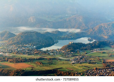 Valley in morning autumn mist, lake Bled with the castle and the church on the island, Slovenia, Europe