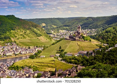 "Valley of Moselle in germany / City of Cochem with ""Reichsburg Castle"" in wine growing area of Moselle / Historic city in Germany"