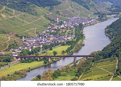 Valley of the Moselle River with vineyards, a railway bridge and the village Ediger-Eller in Rhineland-Palatinate, Germany